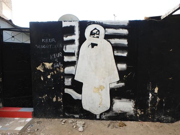 街のあちこちで見掛けるセネガルのイスラム教二大宗派の一つ、ムーリッド教団の創始者アマドゥ・バンバ Ahmadou Bambaの肖像画